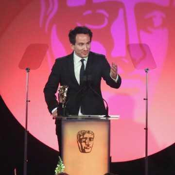 Marcel Mettelseifen accepts the award for Photography: Factual at the British Academy Television Craft Awards in 2015