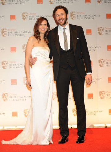 Bridesmaids stars Chris O'Dowd and Kristen Wiig presented the Outstanding Debut BAFTA to director Paddy Considine for his film, Tyrannosaur. O'Dowd is in Hackett, Wiig is wearing Alberta Ferretti.