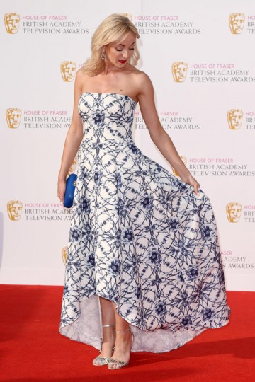 Helen George shows off her dress on the red carpet
