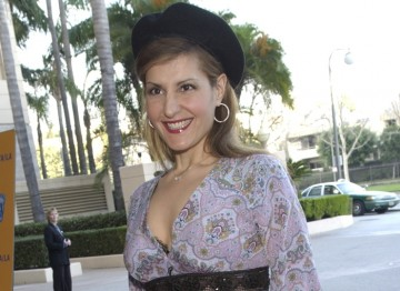 Nia Vardalos arrives on the red carpet.