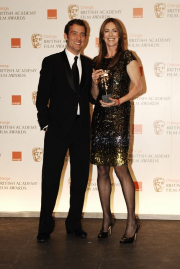 Clive Owen presents Kathryn Bigelow with the award as she wins the Director category (BAFTA/Richard Kendal).