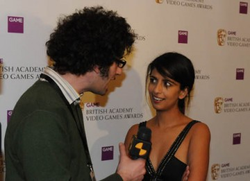 Television presenter and self-confessed casual gamer Konnie Huq is interviewed after presenting the Gameplay Award (BAFTA / James Kennedy).