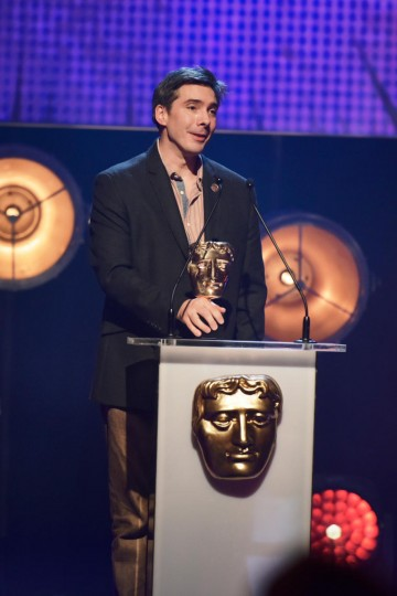 Guy Burt collects the BAFTA for Writer at the British Academy Children's Awards in 2015