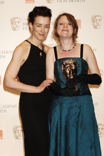 Emma Lazenby poses with Olivia Williams after collecting the Short Animation Award for Mother of Many on behalf of co-nominee Sally Arthur (BAFTA/Richard Kendal).