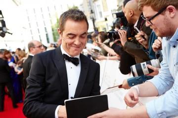 Leading Actor nominee James Nesbitt signs an autograph for a fan