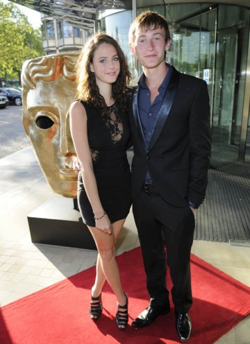 Skins actor Kaya Scodelario arrives on the TV Craft Awards red carpet with Shameless star Elliott Tittensor to present the BBC Blast and BAFTA Screen-Skills Award.