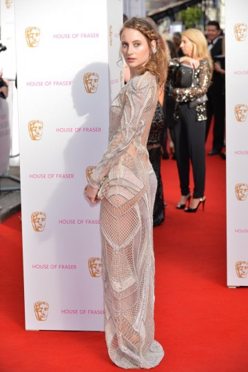 Rosie Fortescue strikes a pose on the red carpet. Jewellery by CARAT*, hair by Mark Hill