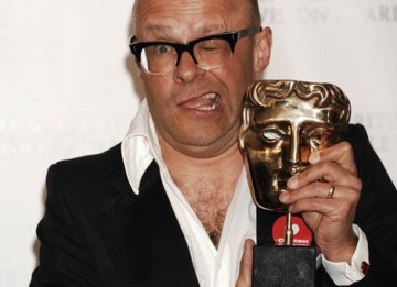 Harry Hill celebrates his Best Entertainment Performance win for his eponymous Tv Burp - his third win for the programme in two years (BAFTA / Richard Kendal).