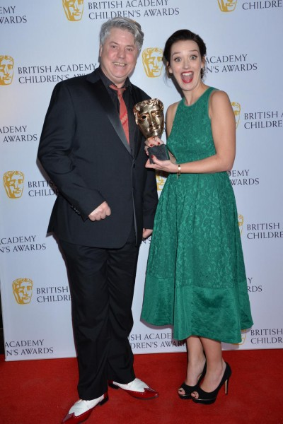 Jessica Ransom, winner of the Performer category for her role in Horrible Histories, with Mark Little, who presented her with the award