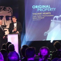 The Valiant Hearts team accept the award for Original Property at the British Academy Games Awards Ceremony in 2015
