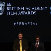 Stephen Fry and Sam Claflin take to the podium to reveal the nominations for the EE British Academy Film Awards in 2015.