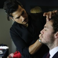 Sam Claflin is styled by a Lancôme make up artist ready for the EE British Academy Film Awards nominations announcement on 9 January 2015