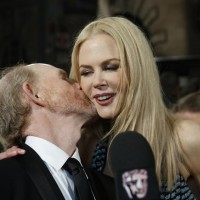 Ron Howard gives fellow nominee Nicole Kidman a kiss