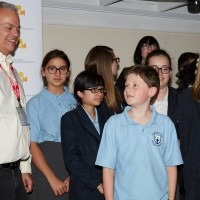 Director, editor Mark Solomon with students from St Michael's Catholic School