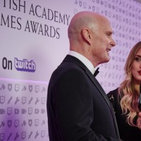Naomi Kyle interviews David Bateson, the voice of Hitman, on the red carpet