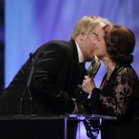 Philip Seymour Hoffman accepts his BAFTA from Imelda Staunton.