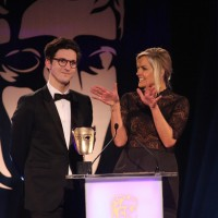 Dan Croll and Katy Hill present the award for Audio Achievement at the British Academy Games Awards Ceremony in 2015