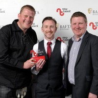 Pictured left to right - Martyn Robertson, Marty Docherty with presenter Mick McAvoy who won Factual for 'Marty Goes To Hollywood.'