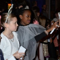 Children getting red carpet ready in Monsoon accessories