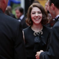 Catherine Steadman, who joined the Downton Abbey cast as Mabel Lane Fox in the show's fifth season, laughs on the red carpet.