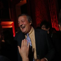 Stephen Fry talks with guests