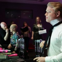 Freddie Fox straightens his tie before he goes on stage