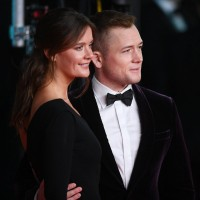 Emily Thomas and Taron Egerton