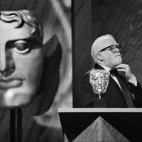 Richard Attenborough celebrates winning the Alexander Korda Award for Best British Film for Shadowlands at the British Academy Film and Television Awards in 1994.