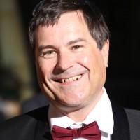 David Braben arrives on the red carpet ahead of his BAFTA Fellowship award