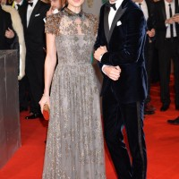 Eddie Redmayne and wife Hannah Bagshawe arrive on the red carpet
