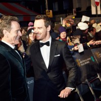 Bryan Cranston and Michael Fassbender share a joke on the red carpet