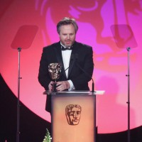 Yan Miles accepts the award for Editing: Fiction at the British Academy Television Craft Awards in 2015