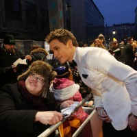 Eddie Redmayne with fans on the red carpet