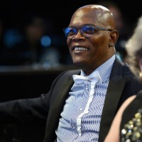 Samuel L. Jackson watching the Britannia Awards from his table.