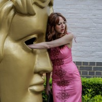Diane Morgan gets up close and personal with the BAFTA mask