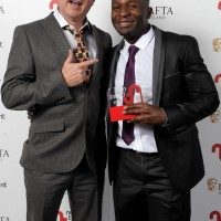 Pictured left to right - Presenter Michael Hines and Nick Ikunda who won Actor for 'Happy Together.'