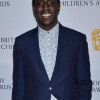 Presenter Andy Akinwolere on the red carpet at the British Academy Children's Awards in 2014