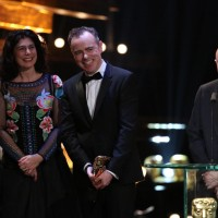 Nick Hornby and the team for Brooklyn accept their award for Outstanding British Film at the EE British Academy Film Awards
