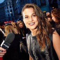 Leading and Supporting Actress nominee Alicia Vikander is interviewed on the red carpet