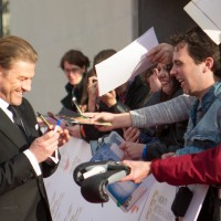 Sean Bean signs autographs for waiting fans