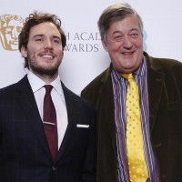 Sam Claflin and Stephen Fry pose for photos after announcing the nominations for the EE British Academy Film Awards in 2015