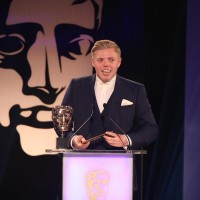 Rob Beckett presents the award for Mobile & Handheld at the British Academy Games Awards Ceremony in 2015