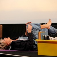 Emma Thompson does yoga on stage at the BAFTA and BFI Screenwriters Lecture Series in 2014