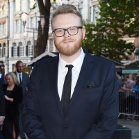 Ceremony host Huw Stephens arrives on the red carpet