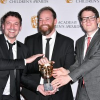 Ben Bocquelet, Mic Graves and Joe Parham, writers of The Amazing World of Gumball, with their award
