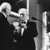 Sir Alec Guinness accepts the BAFTA Fellowship from Sir David Lean in 1989.