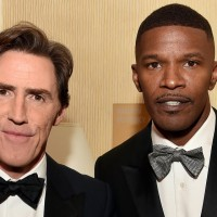 Host Rob Brydon (L) and actor Jamie Foxx
