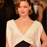 Holliday Grainger looks striking in a black and white V neck dress as she poses on the red carpet