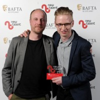 Lewis Bolton (right) with his award for Animation for 'Domestic Appliances with Presenter Jonny Harris