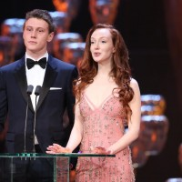 George MacKay and Olivia Grant arrive on stage to present the British Short Film and British Short Animation awards